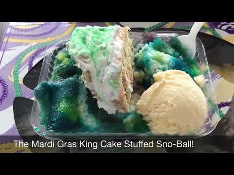King Cake Stuffed Sno-Ball!  Happy Mardi Gras.