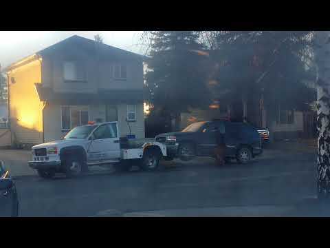 Neighbor getting towed