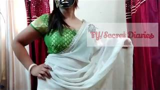 Booby masked aunty wearing sari showing huge cleavage and big navel