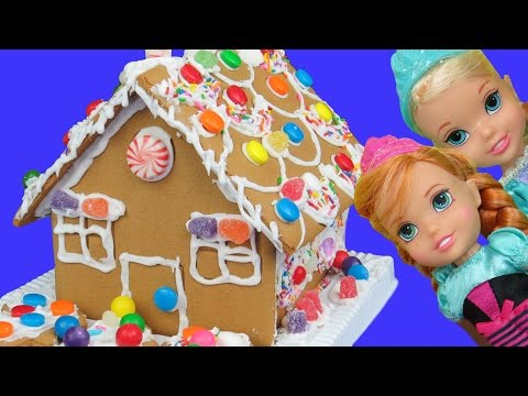 Gingerbread house BUILDING ! ELSA, ANNA toddlers use icing and candy