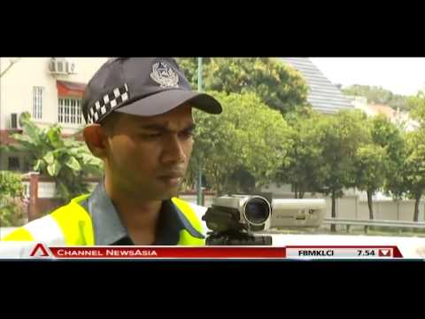 Traffic Police's auxiliary officers issue over 3,600 summonses in 5 months - 30Sep2013