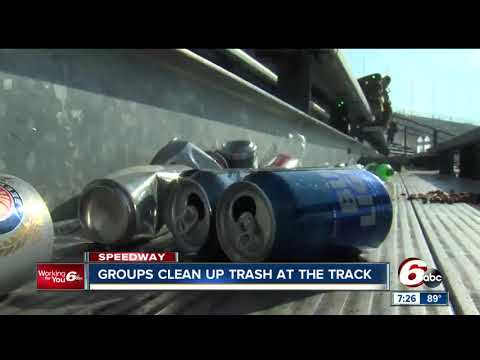 Volunteers help clean up stands at the Indianapolis Motor Speedway