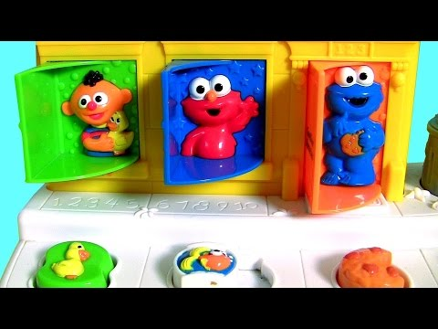 Baby Sesame Street Pop-Up Pals Surprise Toys   Learn Colors Singing C is for Cookie Monster + Elmo
