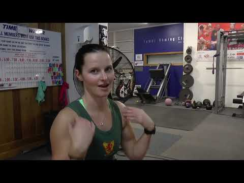 How should you hold your elbows at the finish of the rowing stroke