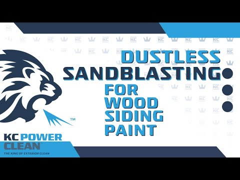 Dustless blasting to strip paint off a wood siding home