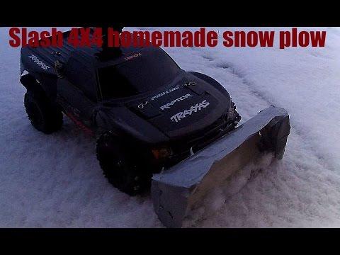 Custom Traxxas Slash 4X4 plowing the driveway with Homemade Snow plow!
