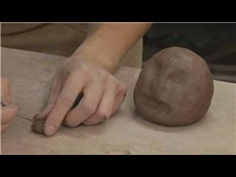 How to Make Pinch Pots : Making the Eyes of a Face on a Clay Rattle