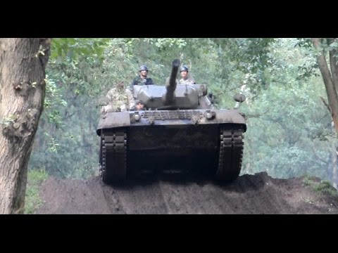 Leopard tanks driving in the wood - Tanks in Town
