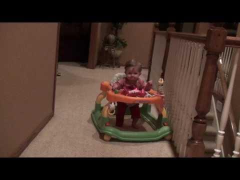 Layla using walker on carpet