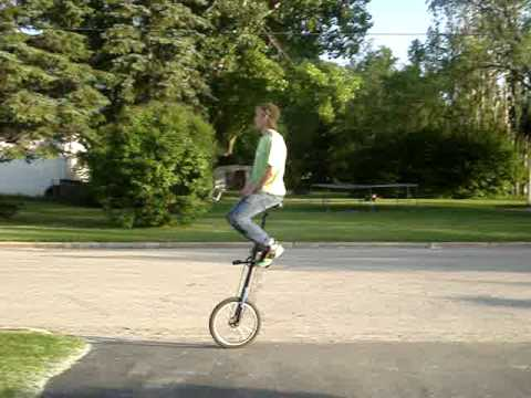 unicycle free mount on 5 foot  giraffe