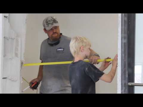 Installing a commercial door in a concrete wall.