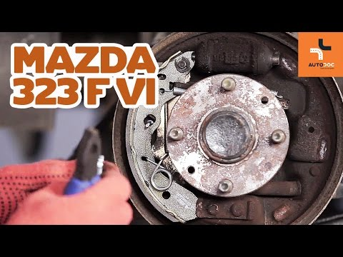 How to replace rear brake drums and rear brake pads on MAZDA 323 TUTORIAL | AUTODOC