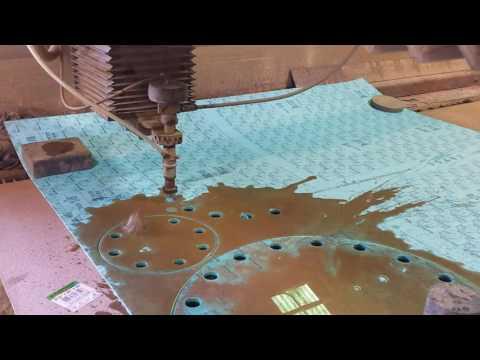 Abrasive Waterjet cutting blind flange gaskets.