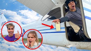 WE THREW HIS GIRLFRIEND'S PHONE OFF AN AIRPLANE!