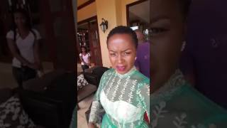 Kansiime attempts to slay in green. Kansiime dairies.