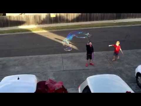 Making giant bubbles at home in our street!