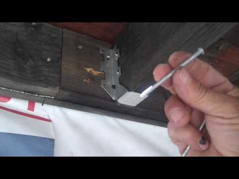 Installing a joist hanger.