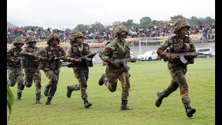 Army marches side b y side with students to remove Mugabe.