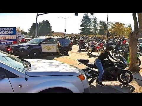 COP PULLS OUT GUN ON RIDER!! *POLICE CHASE*