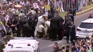 Pope Francis stops popemobile to comfort Chilean policewoman who fell from horse