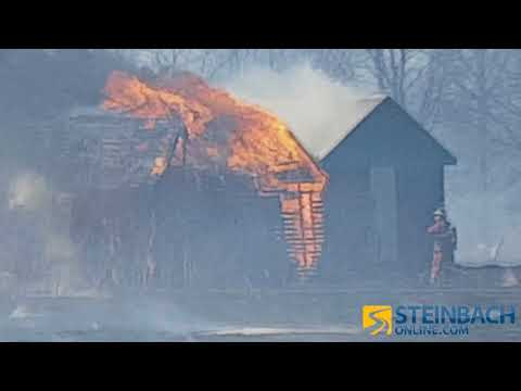 Buildings Go Up In Flames During Grass Fire