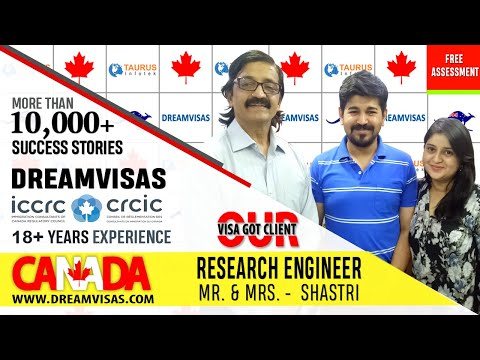 Dipen, Research Engineer, receiving his PR of Canada from Manoj Palwe