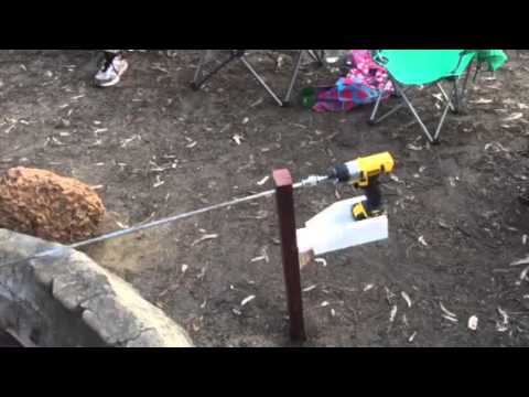 Campfire rotisserie with battery drill