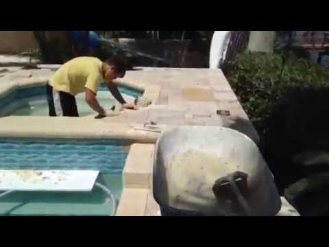 Pool Deck Travertine Install St. Petersburg, Florida - Grouting The Coping