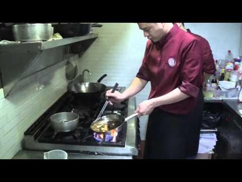 Japanese Master Lin prepares an oyster dish at Maison Asano