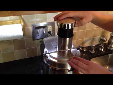 Making orange juice with the power juicer pro. By How-to Bob
