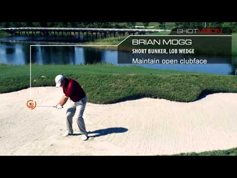 Brian Mogg hitting out of the bunker with a lob wedge shot