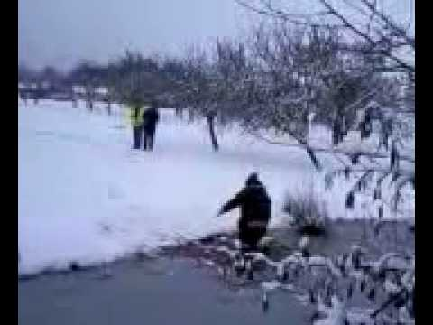 Stupid Bloody Aussie flys off sled into ice lake.