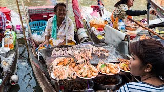 thai food at amphawa floating market thailand seafood feast cooked on a boat