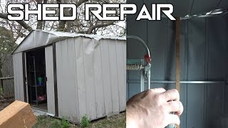 Repairing shed with car jack and some wood