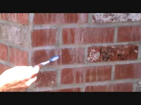 How to clean concrete film from brick wall