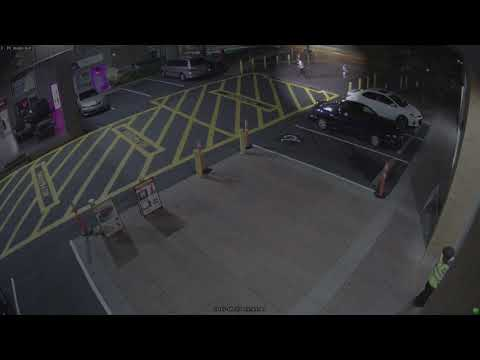Video of Kristina Ward and unknown male walking through parking lot
