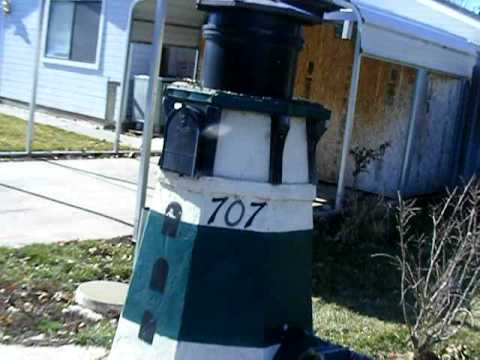 a mailbox shaped like a light house