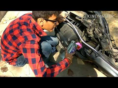 Servicing of Honda activa and oil changing and air filter cleaning simple and easy way try it out .