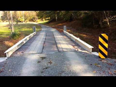 Low cost timber deck bridge