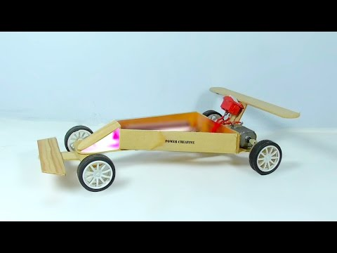 How to make a racing car  using dc motor from wooden