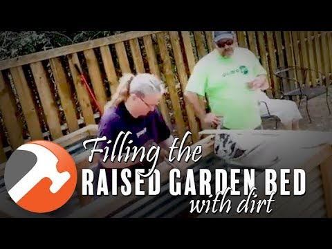 Filling the Raised Garden Bed With Dirt
