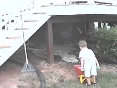 Eddie and Dan spreading Rocks under Deck - Summer - 2003