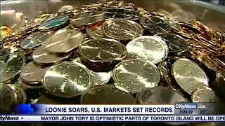 Business report: Loonie soars above 80 cents