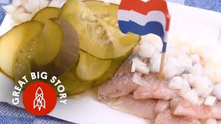 Slurping Down Headless, Raw Fish in the Netherlands