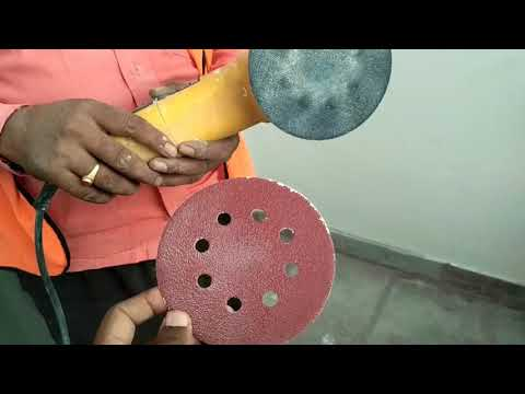 Remove cement, paint stains on tile by using grinder,  velcro disc,  sanding paper