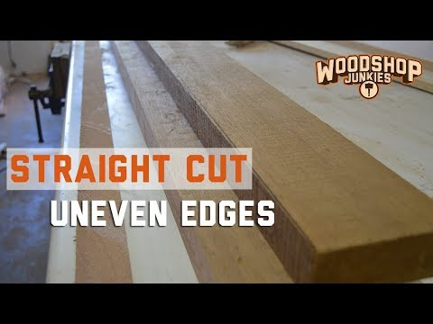 Easiest way to straight line rip cut rough edges using a table saw