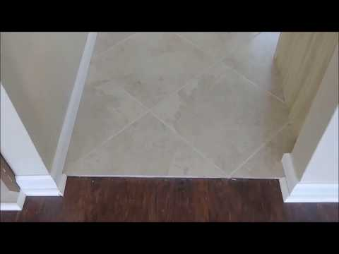Transitions Thresholds  Between Tile and Laminate Floor - Transparent Transition.