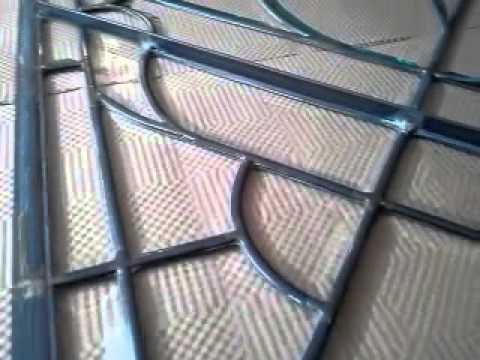 Repair of a leaded glass door panel
