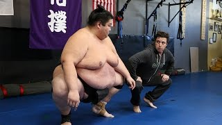 'Average Andy' with World Sumo Champion Yama