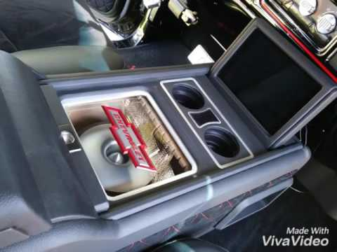 Chevy truck custom subwoofer center console with sliding compartments.